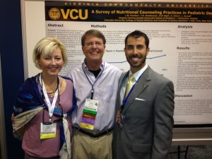 Mrs. Beth Sarrett, Dean David Sarrett and Louis Formica in front of his award-winning research poster.