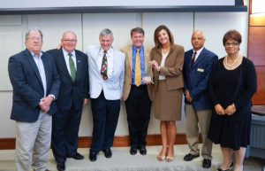 (Left to right) Dr. James Muehleck (D.D.S. '75), Dr. Mark Crabtree (D.D.S. '85), Dr. Edward Snyder (D.D.S. '82), Dean  David Sarrett, Allyson Rothrock, DeWitt House and Cynthia Ingram.