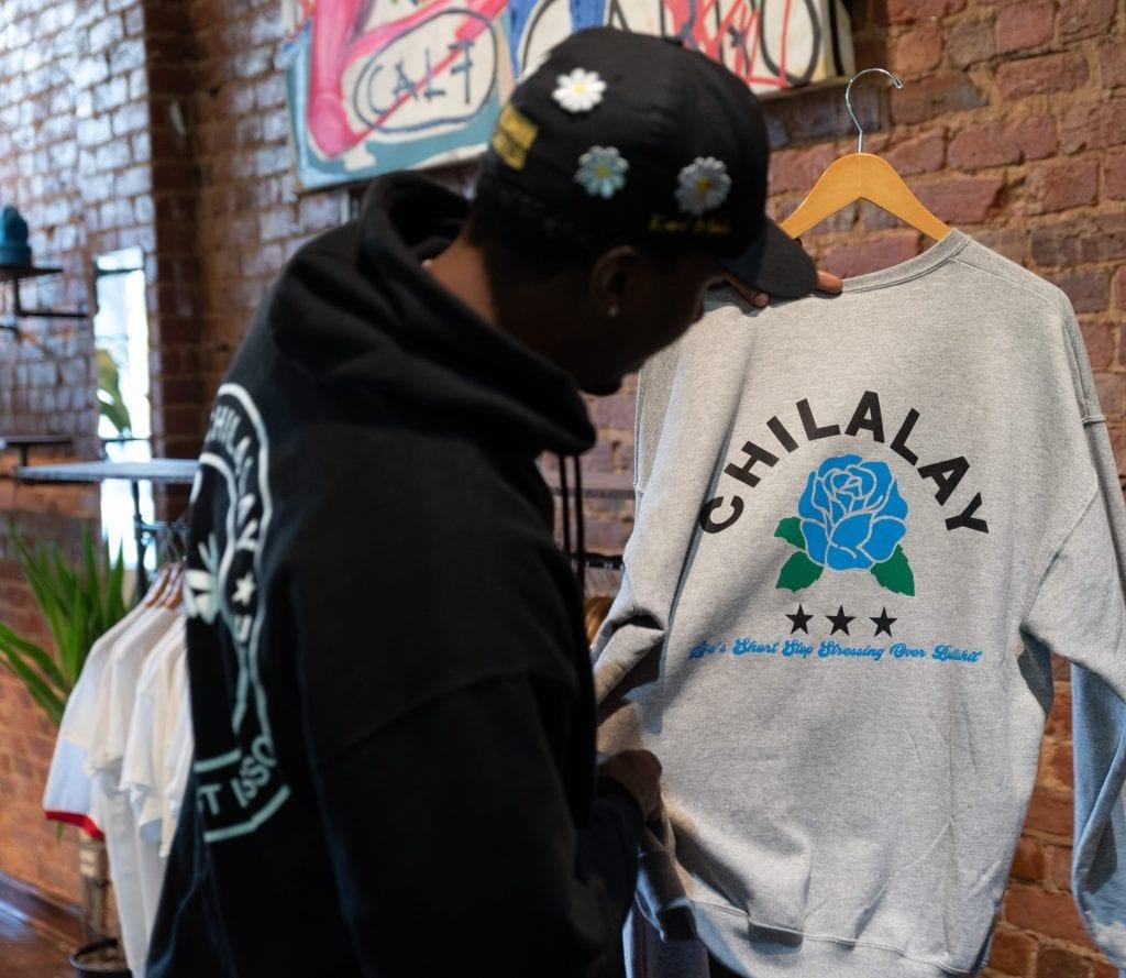 Earl Morris displays a Chilalay branded sweatshirt.
