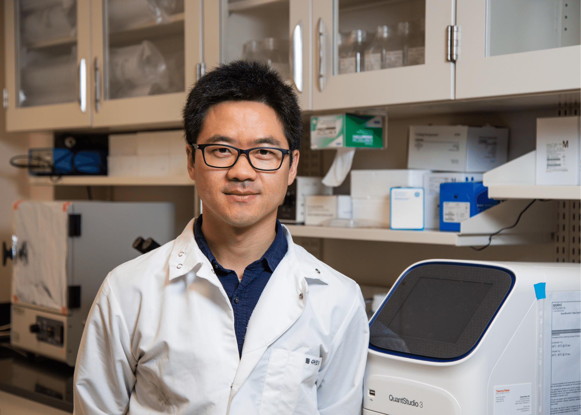Portrait of Guizhi Julian Zhu in his lab.