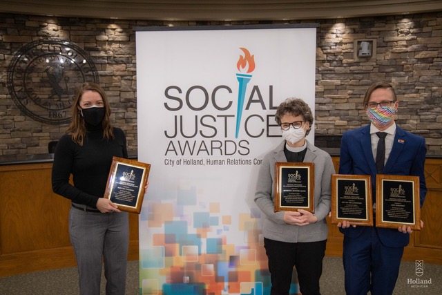 Sara Van Tongeren, Rev. Jane Addams and Jeffrey Sorenson pose with their social justice awards from the city of Holland, Michigan
